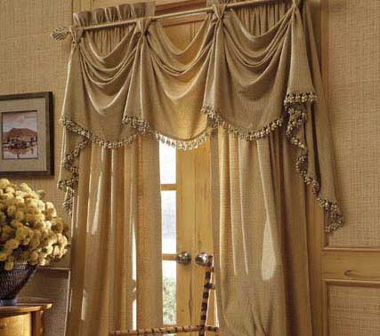 Gold window covering with fancy talk drapes with picture beside, custom window coverings, modern window coverings.